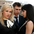 Jealousy - two girl and man — Stock Photo