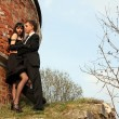 Young lovely couple beside old house — Stock Photo #2757797