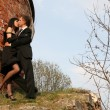 Young lovely couple beside old house — Stock Photo