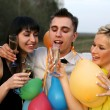 Two girl and man with wine — Stock Photo #2759002