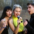 Singers trio — Stock Photo