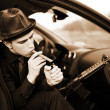 Man in car with cigar and rifle — Stock Photo #2759306