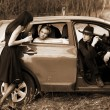 Stock Photo: Two girls, car and man with rifle