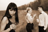 Jealousy - girls and man with wine — Stock Photo