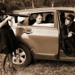 Two girls, car and man with rifle — Stock Photo #2760718