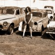 Three girls with vintage car - Stock Photo