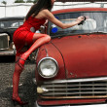 Girl washing vintage car — Stock Photo #2766416