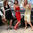 Stock Photo: Funny friends beside retro cars