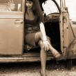Stock Photo: Girl inside retro car