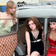 Girls in old car — Stock Photo