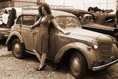 Brunette beside retro car — Stock Photo