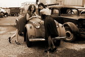 Two girls with vintage car — Stock Photo