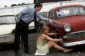 Man and girl - beside retro car — Stock Photo