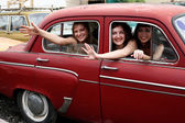Girls in old car — Stock Photo