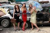 Funny friends beside retro cars — Stock Photo