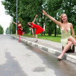 Hitch-hiking girls in the road — Stok fotoğraf