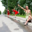 Hitch-hiking girls in the road — Stock Photo