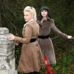Two girl in fall park in old bridge — Stock Photo