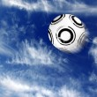Soccer ball in blue sky — Stock Photo