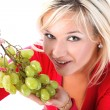 Girl with fresh grape isolated on white — Stock Photo