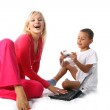 Mom and son with pc and digital photo — Stock Photo