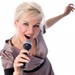 Blonde with mic isolated in white — Stock Photo