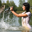 Photographer in water — Stock Photo