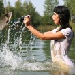 Photographer in water - Stock Photo