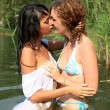 Foto Stock: Girls kiss