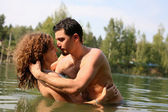 Couple in water — Stock Photo