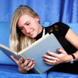 Woman read book at home in sofa — Stock Photo #2826072
