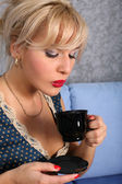 Woman with cup of hot drink — Stock Photo