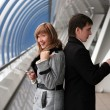 Stock Photo: Man and woman calling