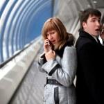 Man and woman speaking phones inside bridge — Stock Photo #2849037