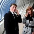Man and woman calling — Stock Photo