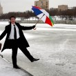 Businessman with umbrella in winter city — Stock Photo #2852202