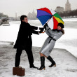 Girl and man fighting with umbrella — Stock Photo