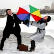 Girl and man fighting with umbrella — Stock Photo #2852582