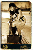 Woman in vintage style with suitcase — Stock Photo