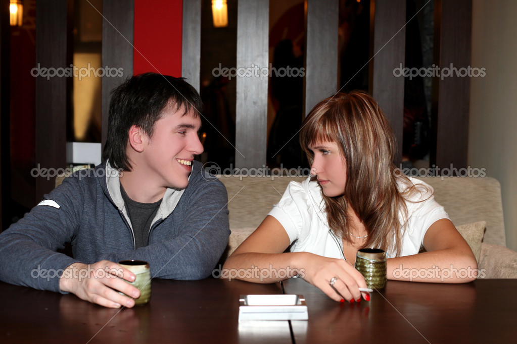 Girl and man in cafe with cups of hot drink  Stock Photo #2862694