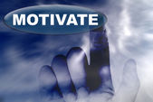 Hand and button with word of MOTIVATE — Stock Photo