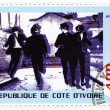 Stock Photo: Stamp with famous group Beatles