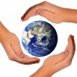 Save the world - hands around earth - Foto Stock