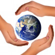 Save the world - hands around earth - Stockfoto