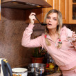 Funny woman cooking dinner — Stock Photo #3005477