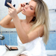 Stock Photo: Womduring daily morning routines