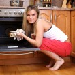 Woman cooking dinner in the kitchen — Stock Photo