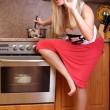 Woman cooking dinner in the kitchen — Stock Photo #3057235