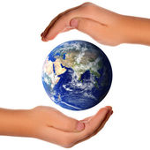 Save the world - hands around earth — Stock Photo