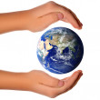 Save the world - hands around earth — Stock Photo #3062451